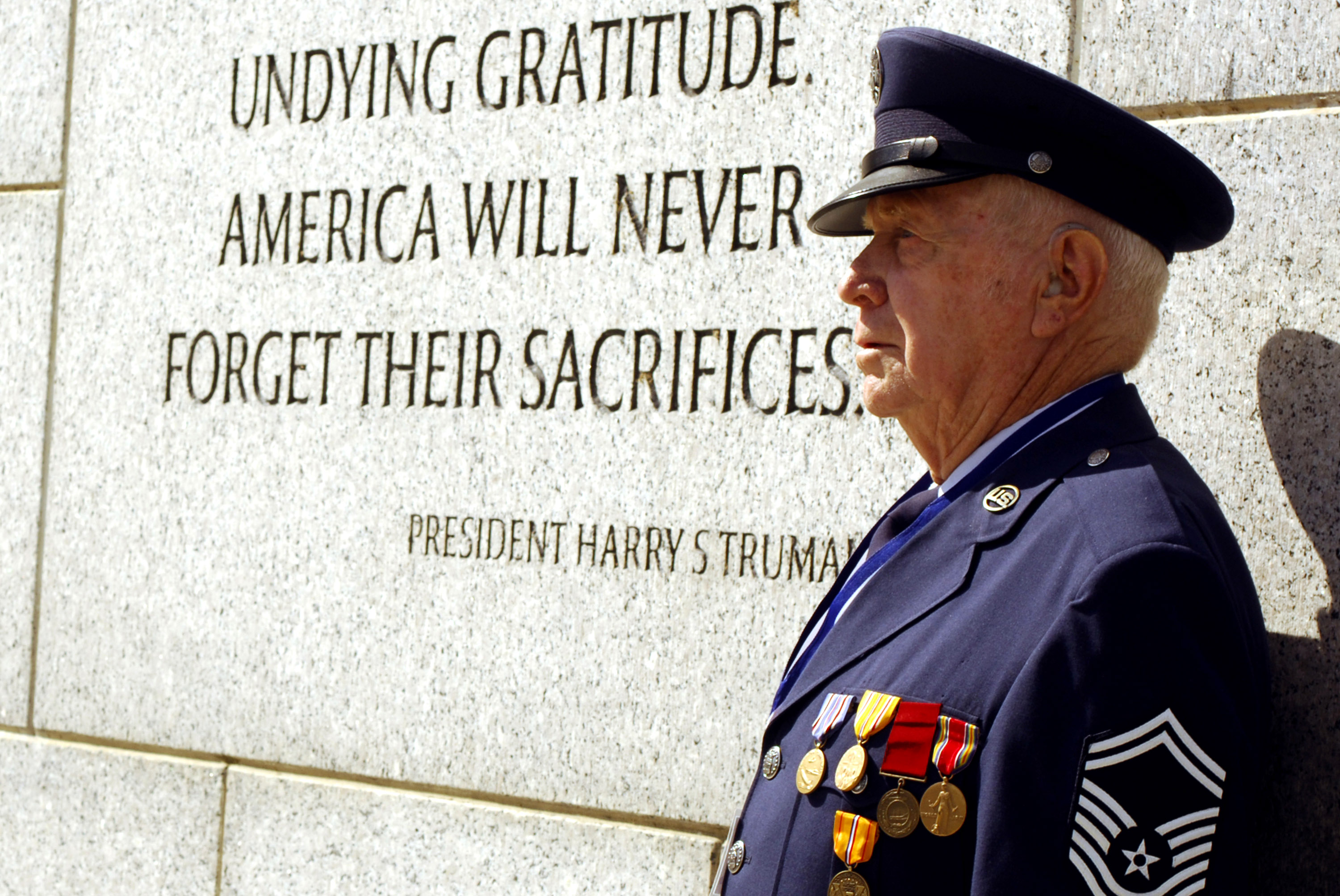 Retired Senior Master Sgt. Billy Neil poses near a quote by President Harry Truman at the National World War II Memorial during Hero Flight 2007 in Washington, D.C., Sept. 15. Hero Flight is an all-volunteer program that sets up trips to allow as many World War II veterans as possible to visit the National World War II Memorial. (U.S. Air Force photo/Staff Sgt. Suzanne Day)